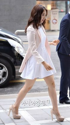 Shin Hye: white dress with muted pastel pink long blazer and nude pumps.