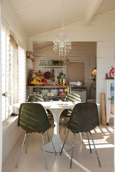 love the white with the olive chairs and the plantation shutter light