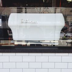 Custom subway tile white paint job for Handsome Coffee's La Marzocco espresso machine...