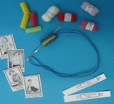"""miniature balls of yarn from drinking straws.  Large page, so when you get there, search for the words """"drinking straws"""" to zip right to the tute."""