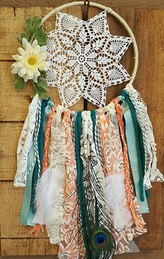This bohemian inspired dream catcher is 7-8 inches in ring size and 18-20 inches long. It would be perfect for a little girls room, your home, wedding or baby shower, or a wedding. These are made to order and all unique in thier own way, which means they may have slight differences from what is pictured but will always reamain as close as possible.