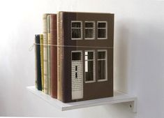 Dutch artist Frank Halmans transforms ordinary stacks of books into charming little buildings. For his series Built of Books, Halmans carves squares and re