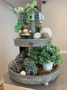Spruce up the office lobby with tiered tray decor! Wooden Tiered Stand, Seasonal Decor, Holiday Decor, Office Lobby, St Patrick's Day Decorations, Tray Decor, St Patricks Day, Farmhouse Decor, Centerpieces