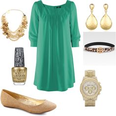 Green dress with gold accessories.