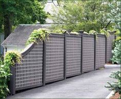 "Stepped Board Inlay Fence - A stepped board fence with a curved end section offers privacy and encouragement to climbing plants. The tan contrasting lattice inlay has 3 1/4"" horizontal/vertical openings."