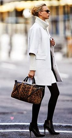 Three quarter sleeve winter white coat and matching turtle neck have a fabulous fifties vibe.
