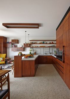 Redesigned kitchen provides a Mid-Century Modern look with modern conveniences.