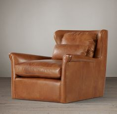 Belgian Wingback Leather Swivel Chair:  think of it in Walnut leather.