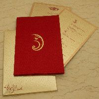 This stylish invitation card is made from high satin cloth and metallic board of fine quality. Card front is covered with designer imprints, beautiful gold Ganeshji printed in gold and contrastive inserts and envelopes are making it totally different! It's awesome.