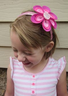 Ombre pink felt flower with pink button centre on pink ribbon wrapped headband on Etsy, $13.50 AUD