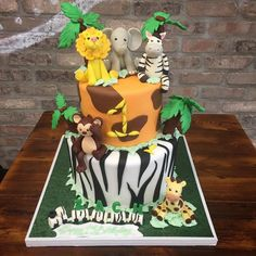 Have a look at this cute Jungle Themed 1st Birthday Cake! #jungle #babyanimals #jungleanimals #lion #zebra #giraffe #elephant #animalprint #cake #1stbirthday #alittlecake #newjersey