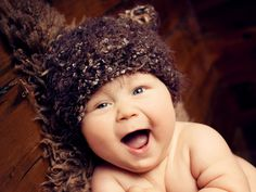 Baby Photos by Jo Frances Wellington, Award Winning Photographer - Amazingly cute photo of a baby wearing a knitted animal hat, by Jo Frances