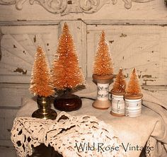 Dyed bottle brush trees in door knobs and wooden spools