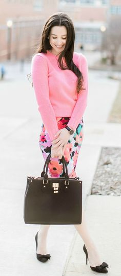 Colorful work outfit idea | Watercolor floral pencil skirt from The Mint Julep Boutique, pink J.Crew Factory crewneck teddie sweater, black bow pumps, Dasein black satchel handbag, and black Daniel Wellington Classic Petite Sheffield watch | how to wear a long pencil skirt | Watercolor Blooms: How to Wear a Floral Pencil Skirt by fashion blogger Stephanie Ziajka from Diary of a Debutante | Catherine Rhodes Photography