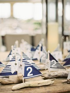 sailboat table markers & favors made out of driftwood for nautical wedding - cutest thing ever!