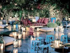 Moroccan garden vibe. Straw stools and cute lanterns.