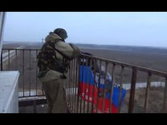 "[eng subs] Givi's ""Somali"" battalion flag over the Donetsk airport runway"