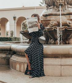 A polka dot maxi wrap dress styled on Emily Vartanian of Stiletto Beats. #styleblogger #fashion #dress #polkadots