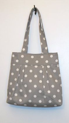 Pleated Tote Bag  Gray Polka Dot, $38.30 CAD Only 1 available  Overview      Handmade item     Material: cotton     Feedback: 26 reviews     Only ships to United States from Florida, United States.      This shop accepts Etsy Gift Cards