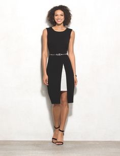 We can't think of a more perfect update of a classic LBD. This one shows off a hint of skin with a pop of white peeking from underneath. A snakeskin belt adds a subtle pop of pattern for a chic touch. Imported.