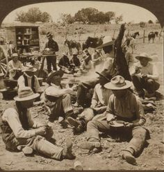 """Cowboys at dinner /Images of the Old West /Scene at Noon Hour in a Typical Cowboy Camp of the """"Wild and Wooly West"""" Arizona 1907"""