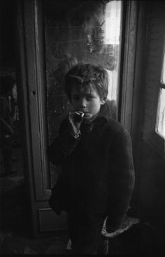 He blew a puff of smoke in my direction, the cigarette hanging carelessly out of the side of his mouth. He couldn't have been older than ten years old. Dark Photography, Black And White Photography, Portrait Photography, Vintage Photographs, Vintage Photos, Henri Cartier, Looks Cool, Character Inspiration, Writing Inspiration