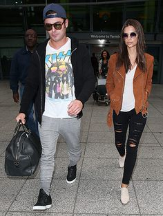 """""""We Are Friends"""" co-stars Zac Efron and Emily Ratajkowski touched down in London in shady style! Gotta love their equally trendy sunnies!"""