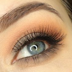 This neutral eye makeup features very light neutral eyeshadow paired with long beautiful eyelashes. Get these products listed to DIY.