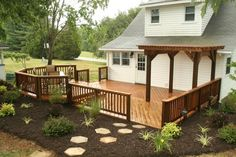 If you're looking for backyard porch or deck ideas, check out this design from the Southeastern Lumber Manufacturer's Association. An arbor and a dining bump-out help to form separate areas on your deck.