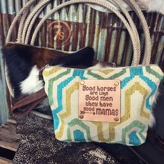 """- Cowhide, southwest tapestry and leather graphic bag - """"Good horses are like good men, they have good mamas"""" graphics - Graphic laser printed on leather patch with brass rivets - Soft variations of t"""