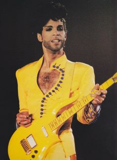 Princein all yellow outfit and guitar