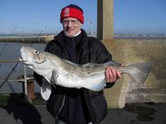 Catches a cod with a plastic bottle inside - gross!