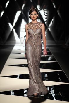 The Mireille Dagher Fall-Winter 2013-14 Haute Couture Collection...Interesting fabric and again very Art Deco lines.