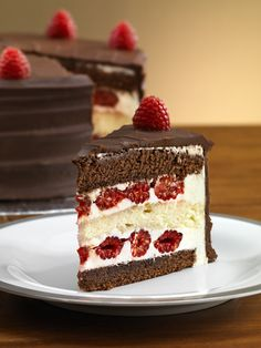 I need to find a recipe for this!  Perfect combo!  Fresh raspberries and chocolate cake!  :-P~