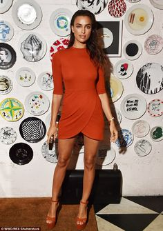 Glowing: The 29-year-old Russian beauty donned a burnt orange dress with three-quarter length sleeves and platform heels
