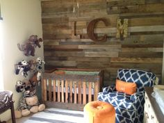 Here is a very creative nursery idea sent in from one of our customers. They used old barn wood for the walls, and even custom built their crib using the same wood. The Best Swivel Glider in blue really pops against the orange ottoman and brown walls. @Ashley Chastain
