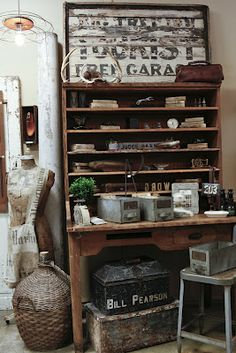 <3  vintage display desk and shelf ~ all kinds of primitive and rustic goodies! (via A Beautiful Mess Antiques)