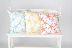 Beach starfish pillow covers coral ,yellow navy blue, light coastal blue.This listing is for TWO pillow covers. You choose same color or mix
