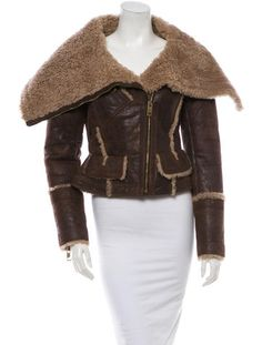 Brown and beige Burberry cracked leather jacket with shearling lining, oversize collar, fitted waist, flap pockets at sides, zip openings at sleeves and front exposed zip closure.