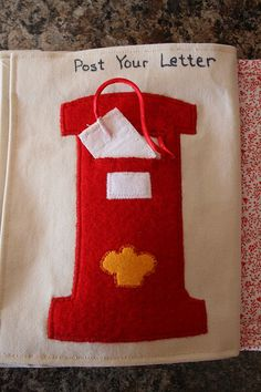 British Inspired Quiet Book: been looking high and low for an applique Pillar Box, and here's a great one! #postbox #british #letterbox maybe add a door and put the letters on a loop