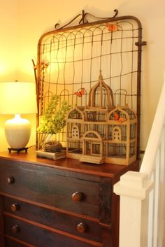 Rusty gate can be used to display photos or old memorabilia with clothes pins. Pins can be painted or left outside for patina.