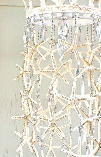 I wanted to create a light fixture that had all of the wow factor of a chandelier dripping with crystals but without the big price tag.... I used 36 white starfish and about 10 yards of crystal cha...