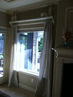DIY curtain rod shelf- I have this in the boys room, but would love it in the living room!