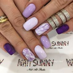 Nail art is a very popular trend these days and every woman you meet seems to have beautiful nails. It used to be that women would just go get a manicure or pedicure to get their nails trimmed and shaped with just a few coats of plain nail polish. Purple Nail Art, Purple Nail Designs, Diy Nail Designs, Lilac Nails Design, Lilac Nails With Glitter, Purple Gel Nails, Nail Design For Short Nails, Flower Design Nails, Summer Shellac Nails