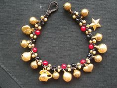 Red coral woven dark brown waxed cord and brass bells bracele on Halloween on Etsy, ฿255.10