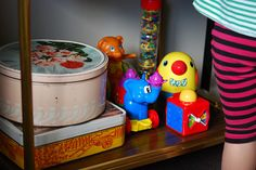 Vintage tins holding baby toys