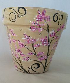 This flower pot has a simple yet elegant cherry blossom motiff. I love the light colors and cool feel. It works great as part of your indoor or outdoor decor. Makes a nice gift! Measures 7 × 7 Clay pot, acrylic paint, poly sealed to protect the design Flower Pot Art, Flower Pot Design, Flower Pot Crafts, Clay Pot Crafts, Painted Plant Pots, Painted Flower Pots, Decorated Flower Pots, Terracotta Pots, Garden Crafts