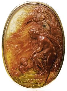 ITALIAN OR FRENCH, CIRCA 1700 CAMEO WITH THE BATH OF VENUS monogrammed: I.R.F. agate, mounted in a gold brooch 53 by 37mm., 2 1/16  by 1½in. overall