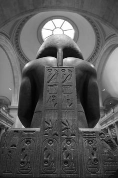 Ancient Egyptian sculpture (note the two cartouches in lower right, essentially mirror images of each other, because hieroglyphs written right to left or left to right)