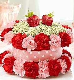 Fresh Flower Cake™ Strawberry Shortcake- cake-shaped arrangement features red and pink mini carnations and white rice flower with bright decorative ribbon and two realistic strawberry picks Fresh Flower Cake, Fresh Flowers, Pink Flowers, Flower Cakes, 800 Flowers, Cake Flowers, Unique Flower Arrangements, Unique Flowers, Beautiful Flowers